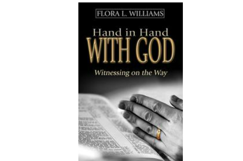 Book cover, image of hands praying over bible