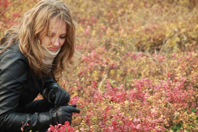 author, Jessica, in a field of flowers