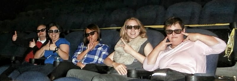 5 friends make silly faces sitting in movie theater