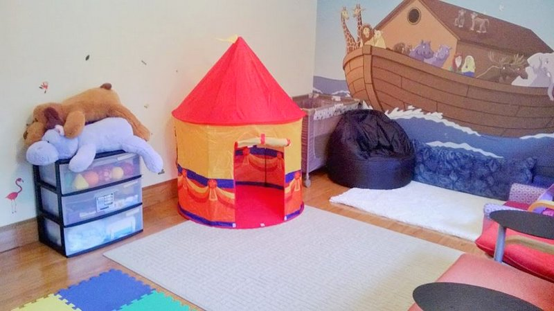room with soft toys, beanbag chair, small tent